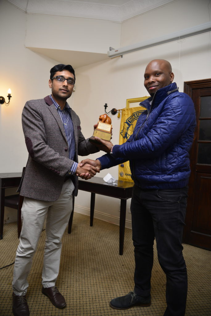 Amiel Holilal handing the grizzly bear to Thokozani Miya for his sterling work as the Toastmaster of the day.